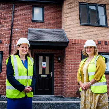 Stafford MP Theo Clarke is pictured outside the new homes with Housing Plus Group chief executive, Sarah Boden
